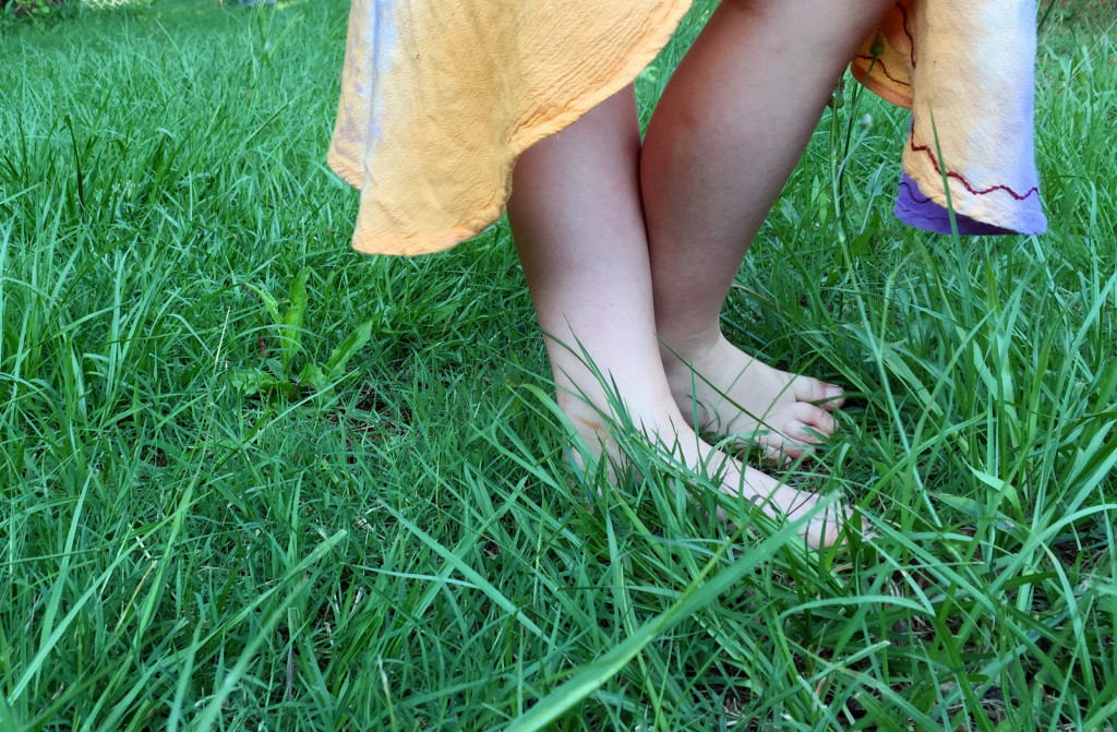 Is there anything sweeter than little bare feet in summer grass?